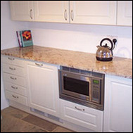 Kitchen showing granite worktops, storage and built-in appliances